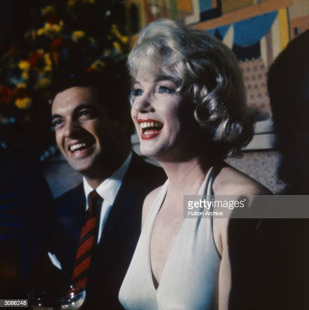 American actress Marilyn Monroe and British song and dance man Frankie Vaughan stars of the film 'Let's Make Love' directed by George Cukor