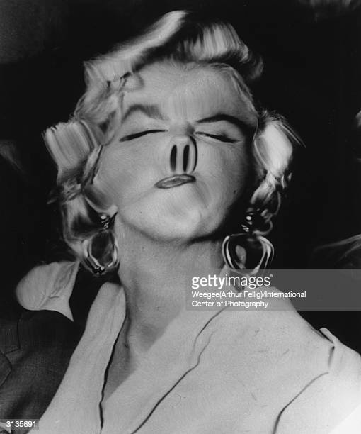 American movie actress and sex symbol Marilyn Monroe with her nose distorted into a snout by Weegee's plastic lens Photo by Weegee/International...