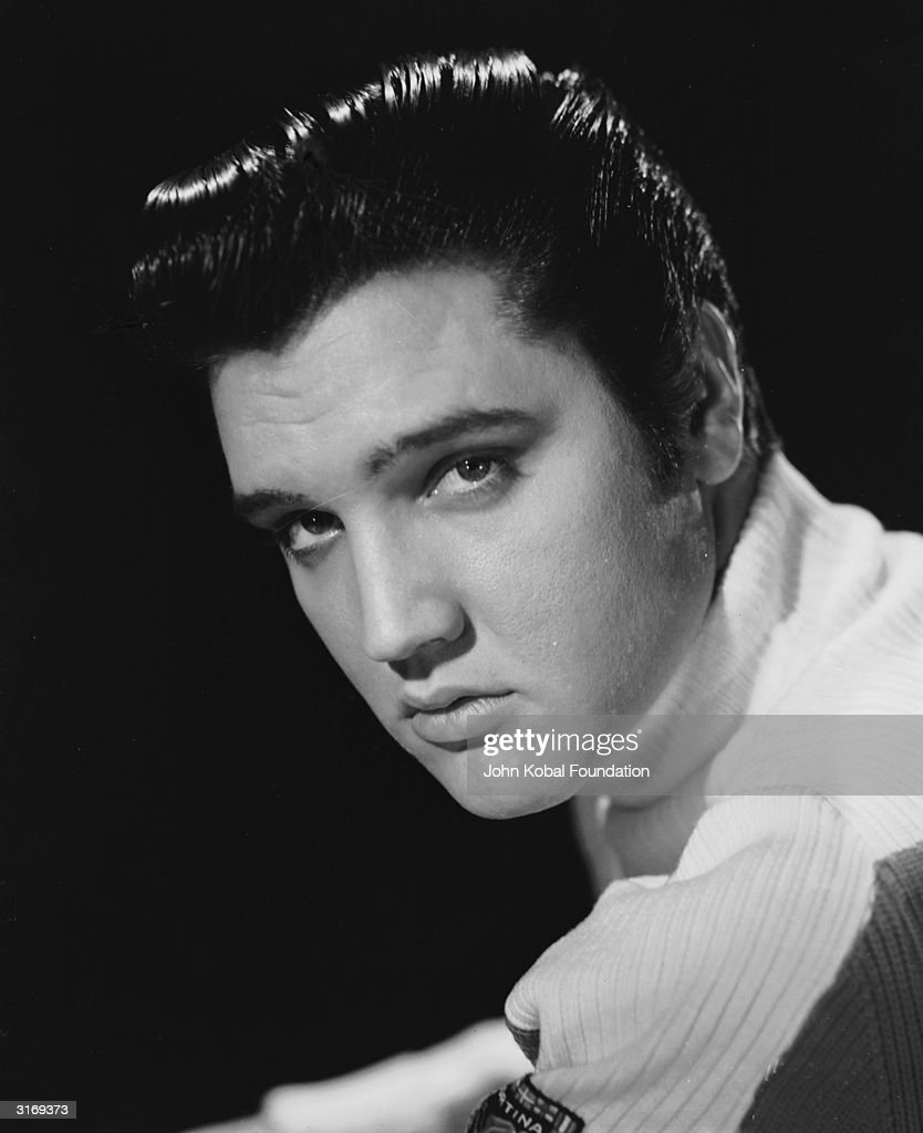 American music and cinematic icon <a gi-track='captionPersonalityLinkClicked' href=/galleries/search?phrase=Elvis+Presley&family=editorial&specificpeople=67209 ng-click='$event.stopPropagation()'>Elvis Presley</a> (1935 - 1977), 'the King of Rock 'n' Roll'.