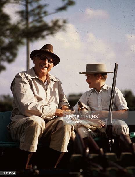 Earl E T Smith the last US Aambassador to Cuba before Castro with his son Earl They are at the Bonnette Hunting and Fishing Club near Palm Beach...