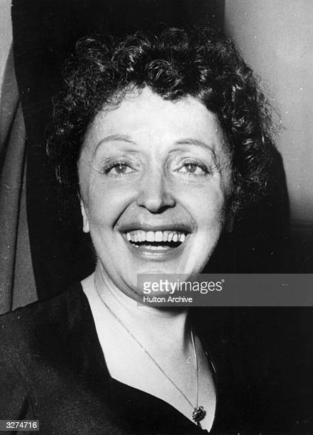 French singer Edith Piaf originally Edith Giovanna Gassion smiling broadly after appearing in a music hall variety performance