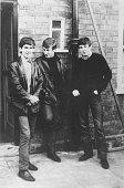Liverpudlian skiffle beat band The Beatles standing outside Paul's Liverpool home George Harrison John Lennon Paul McCartney Ringo Starr was not to...