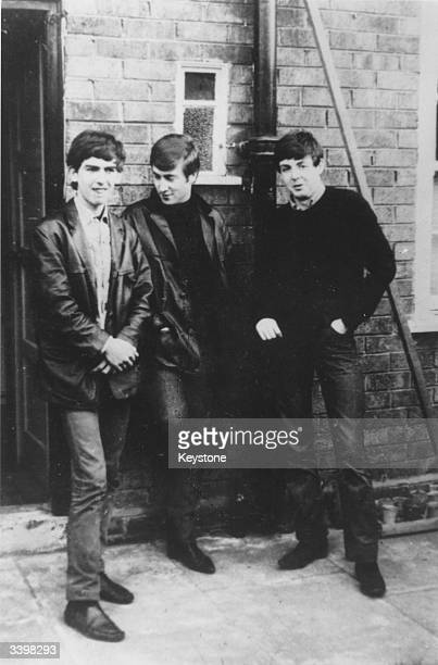 Liverpudlian skiffle beat band The Beatles standing outside Paul's Liverpool home George Harrison John Lennon Paul McCartney Ringo Starr was not to...