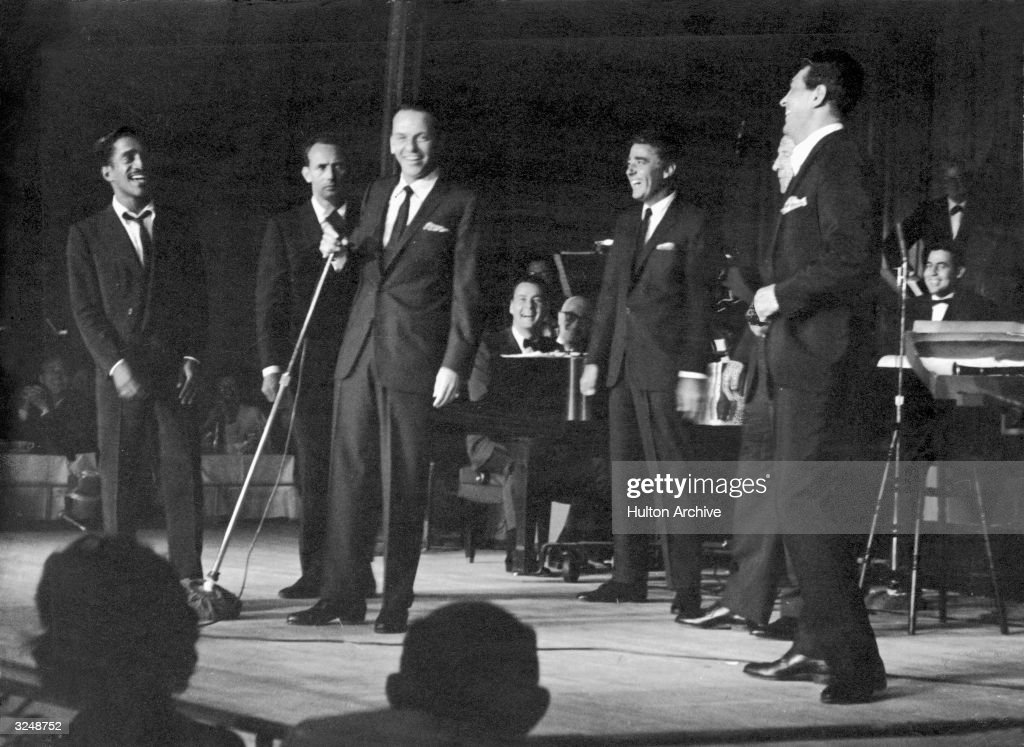 Members of the 'Rat Pack' perform on stage Las Vegas, Nevada. L-R: Sammy Davis Jr. (1925 - 1990), Joey Bishop, Frank Sinatra (1915 - 1998), Peter Lawford (1923 - 1984), an unidentified man and Dean Martin (1917 - 1995).