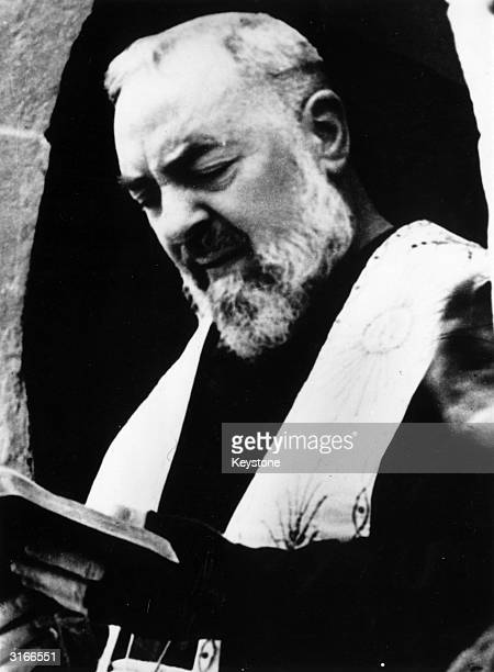 Mystic and Stigmatic Capuchin friar Padre Pio wearing black mittens to cover the stigmata on his hands He bears on his body the five marks of the...