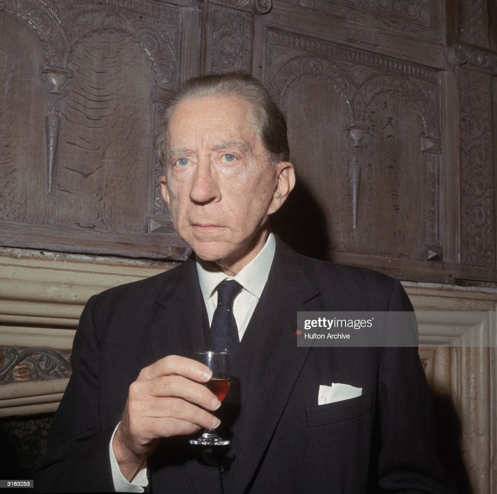 Oil multi-millionaire and art collector, John Paul Getty (1892 - 1976) with a glass of wine.