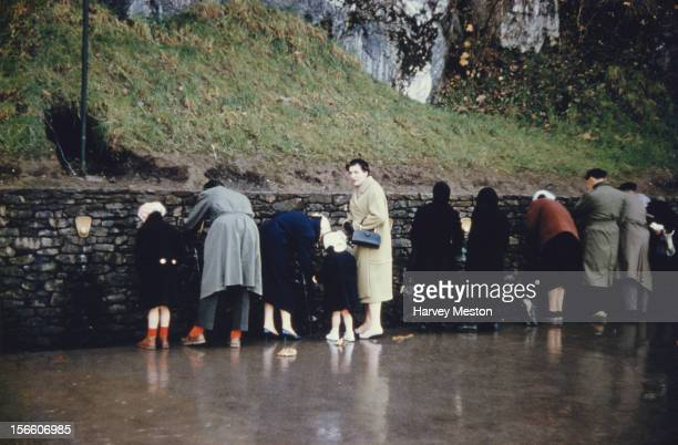 People drinking 'holy water' from the spring in Lourdes southwest France where Bernadette Soubirous claimed to have seen a manifestation of the...