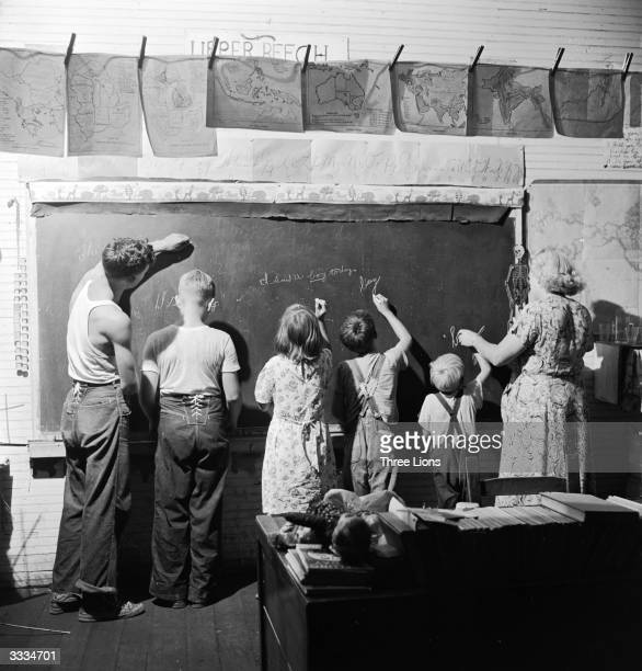 Pupils from five of eight grades under the tutelage of one teacher at a one room schoolhouse in rural Kentucky USA