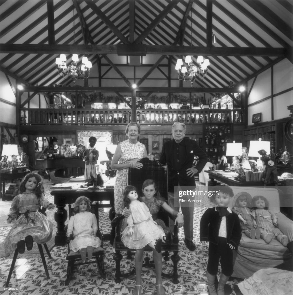 Samuel Pryor, vice-President of Pan American Airways pictured with his wife and daughter, surrounded by an extensive collection of large dolls.