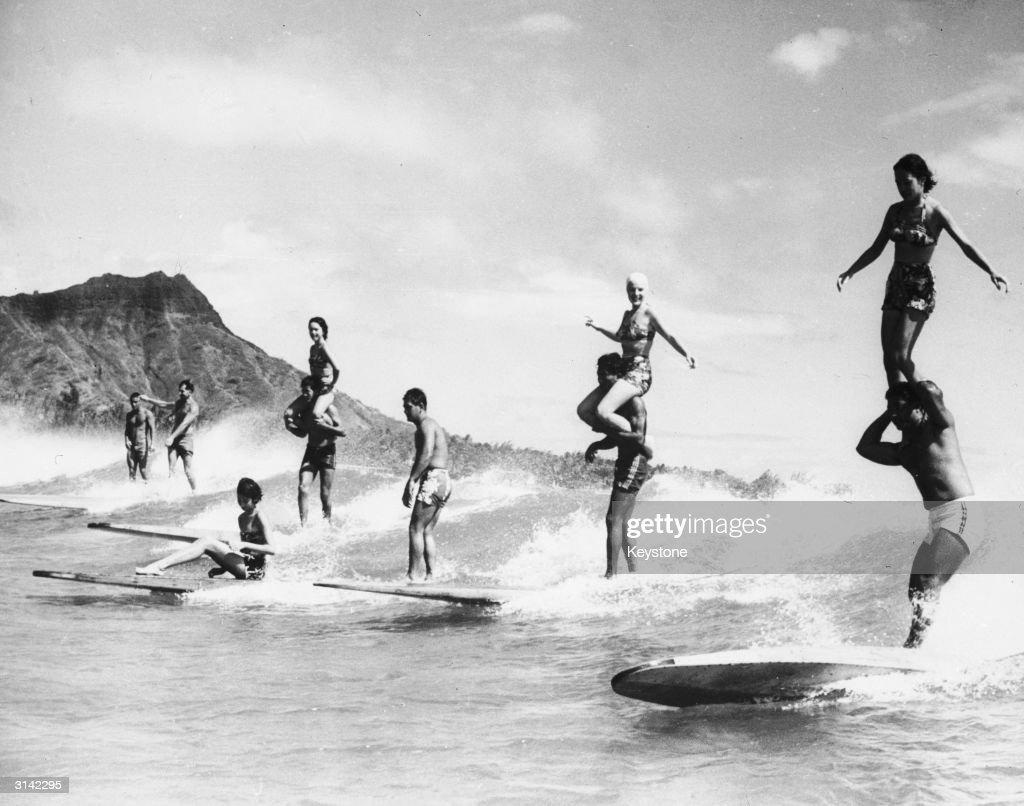 Surfers performing stunts in Hawaii.