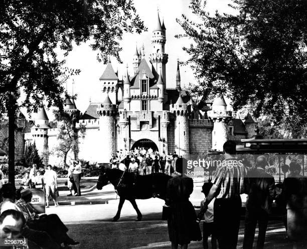 Tourists visiting the medieval 'Sleeping Beauty Castle' at Disneyland