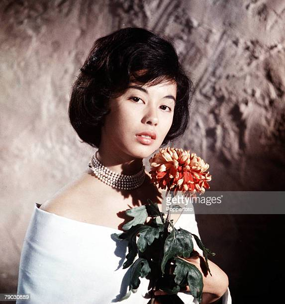 Circa 1960s A picture of the Eurasian actress France Nuyen doing an impression of the Italian beauty Gina Lollobrigida