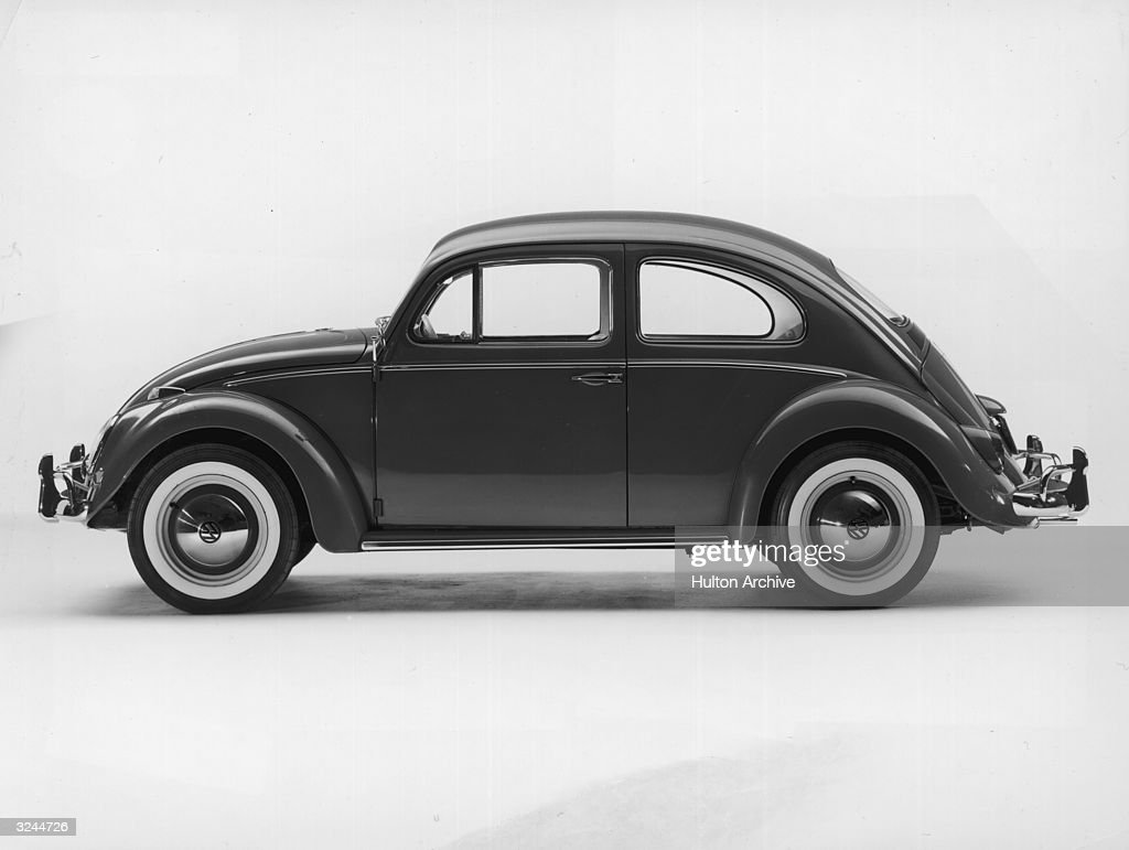 Promotional studio image of a 1962 Volkswagen Beetle Sedan.