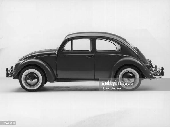 Promotional studio image of a 1962 Volkswagen Beetle Sedan