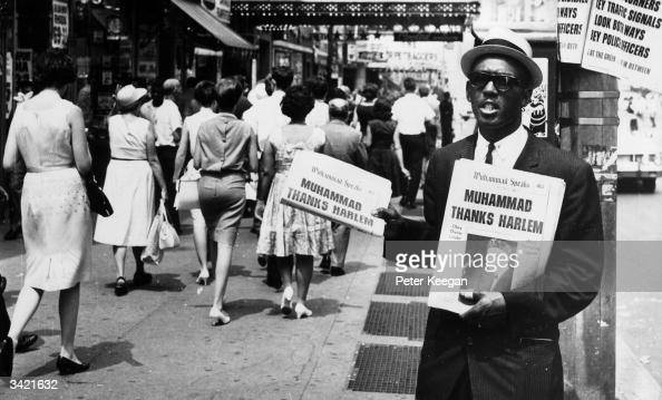 A Black Muslim promotes his cause on a street corner in New York with the 'Muhammad Speaks' newspaper The Muslim advocate secession from the rest of...