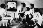 A family watching President John Kennedy on television