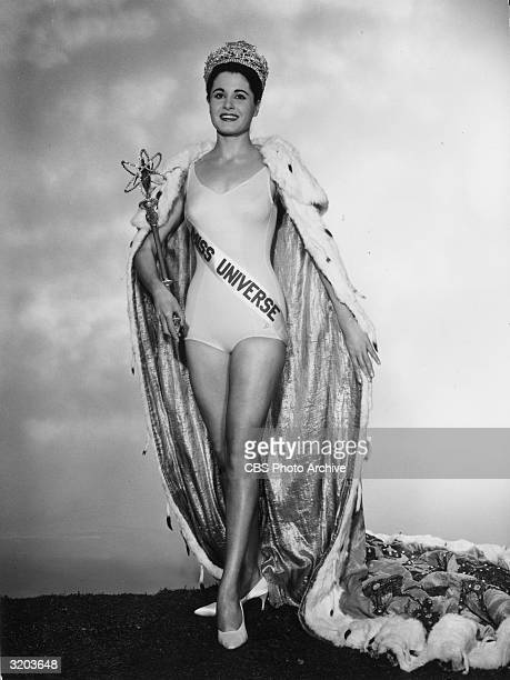 Fulllength portrait of Norma Beatriz Nolan of Buenos Aires Argentina Miss Universe 1962 wearing a crown a bathing suit an erminetrimmed cape and a...