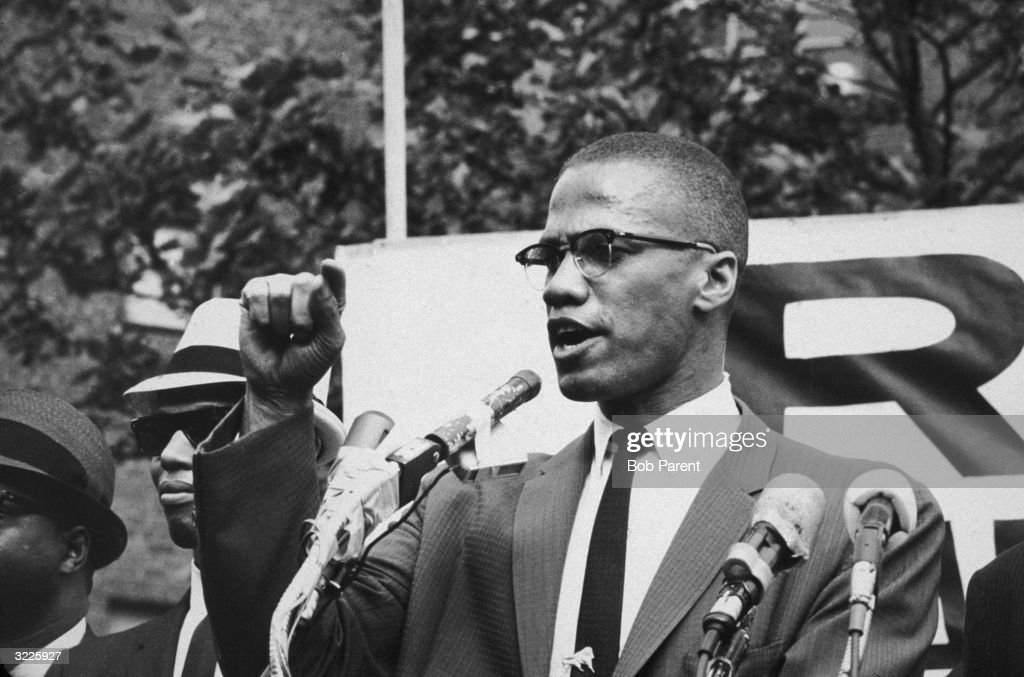 American civil rights leader <a gi-track='captionPersonalityLinkClicked' href=/galleries/search?phrase=Malcolm+X&family=editorial&specificpeople=70045 ng-click='$event.stopPropagation()'>Malcolm X</a> (1925 - 1965) at an outdoor rally, probably in New York City.
