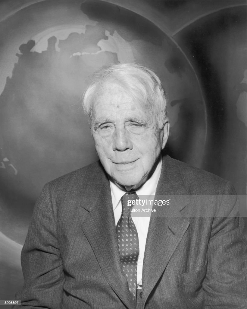 Portrait of American poet <a gi-track='captionPersonalityLinkClicked' href=/galleries/search?phrase=Robert+Frost+-+Poet&family=editorial&specificpeople=213641 ng-click='$event.stopPropagation()'>Robert Frost</a> (1874 - 1963), sitting in front of a globe backdrop for a television program about freedom of the press.