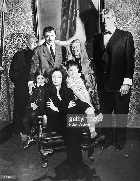 Group portrait of the cast of the television series 'The Addams Family' in costume Standing Jackie Coogan John Astin Blossom Rock and Ted Cassidy...