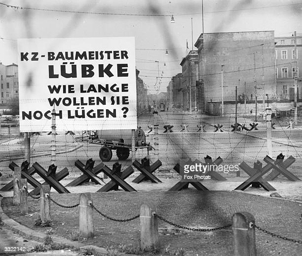 A large sign on the Berlin Wall near the Brandenburg Gate and Potsdamer Platz