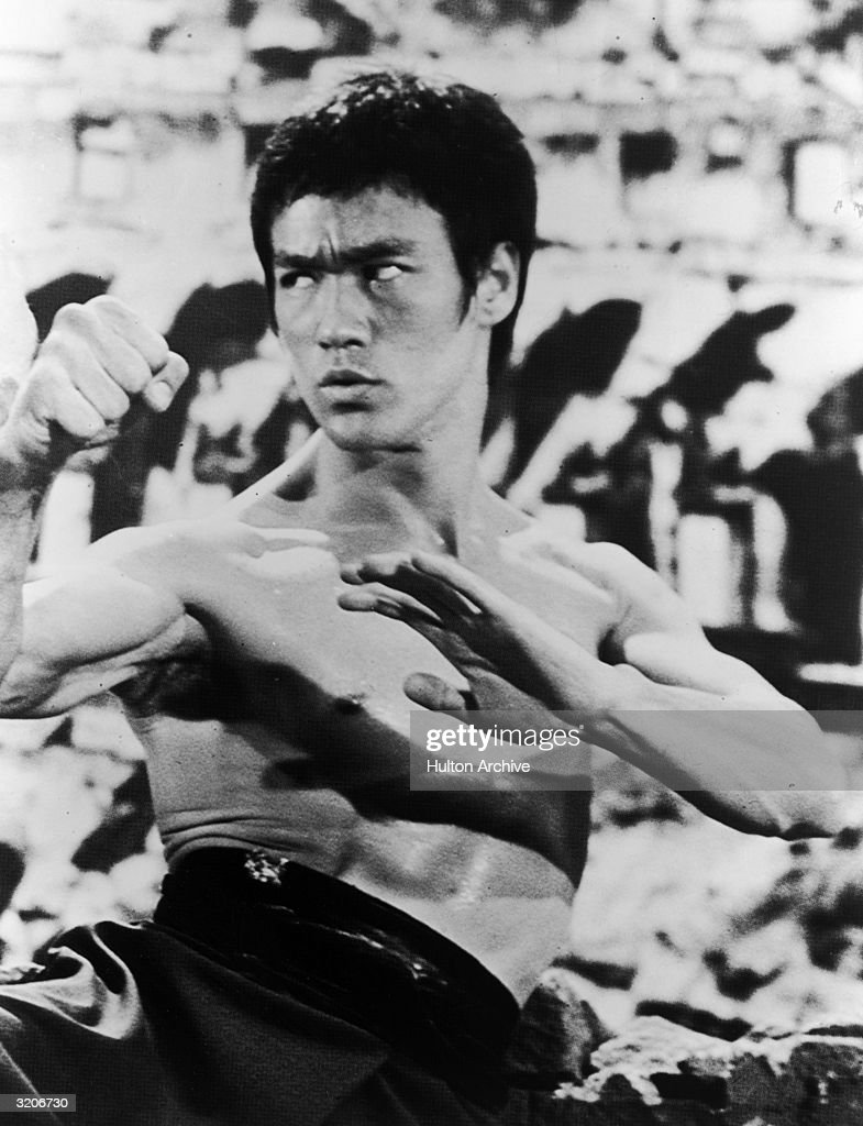 American actor and martial artist <a gi-track='captionPersonalityLinkClicked' href=/galleries/search?phrase=Bruce+Lee+-+Actor&family=editorial&specificpeople=453429 ng-click='$event.stopPropagation()'>Bruce Lee</a> (1940-1973) raises his hands in a defensive stance, during a fight in an unidentified film still.