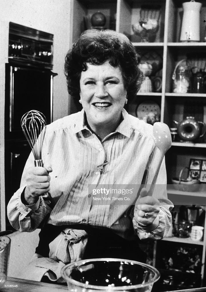 American chef <a gi-track='captionPersonalityLinkClicked' href=/galleries/search?phrase=Julia+Child&family=editorial&specificpeople=206805 ng-click='$event.stopPropagation()'>Julia Child</a> stands in front of a countertop, holding a whisk and a ladle by a mixing bowl, possibly on the set of her television series, 'The French Chef'.