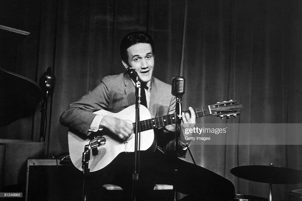 Circa 1965 American country singer songwriter and musician Roger Miller playing the guitar on stage 1960s