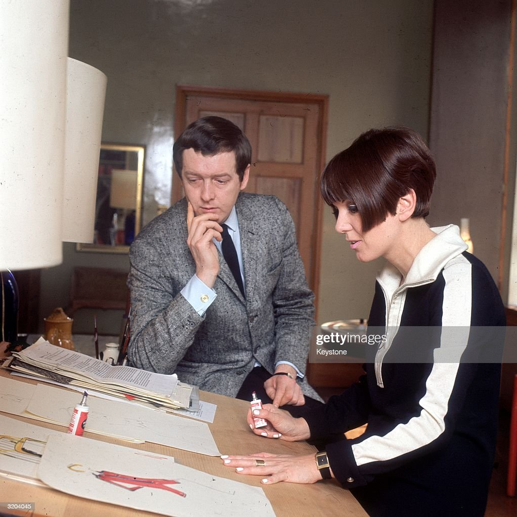 Dress designer Mary Quant at her desk with her husband Alexander Plunkett Greene at their home.