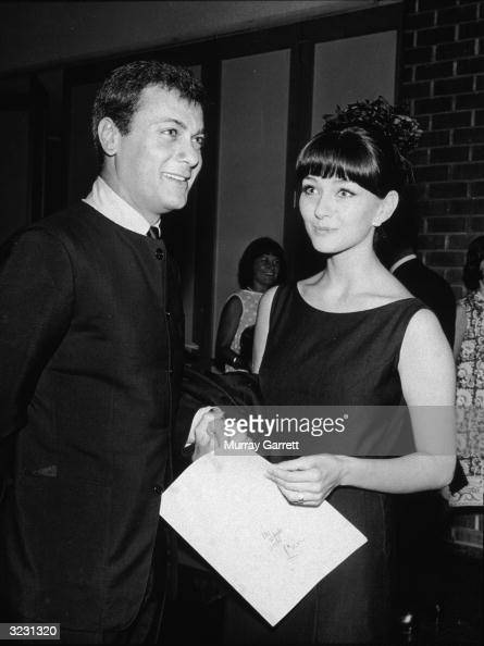EXCLUSIVE American actor Tony Curtis and his wife Austrian actor Christine Kaufmann smile while holding hands at the premiere of director Tony...