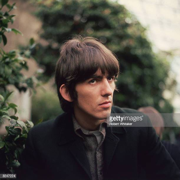George Harrison of the Beatles sporting the group's distinctive haircut during filming at Chiswick House