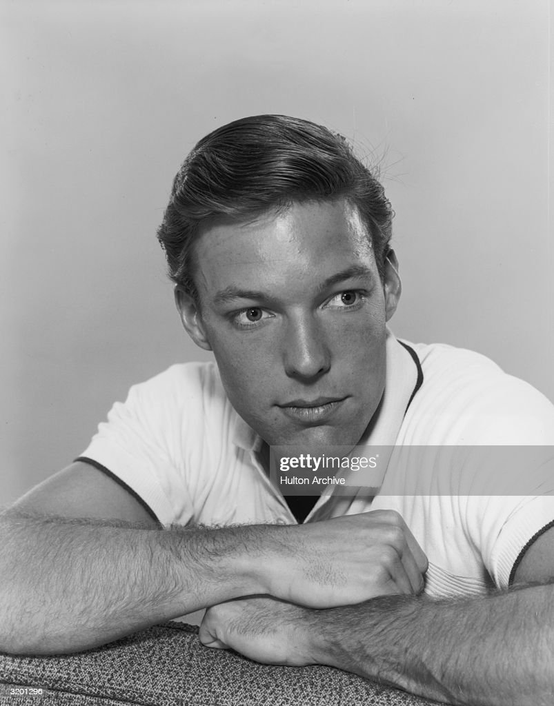 Headshot Portrait Of American Actor Richard Chamberlain Resting His Arms On  A Sofa. He Wears