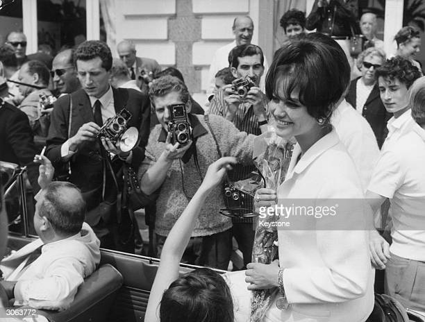Italian actress Claudia Cardinale arrives at Cannes amidst a crowd of fans and photographers