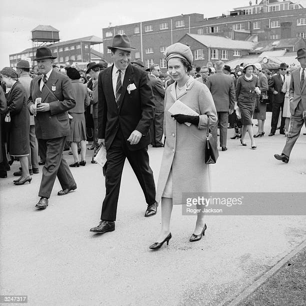 Queen Elizabeth II and Lord Porchester at Newbury Races Lord Porchester took over from Michael Oswald as the Queen's racing manager in 1970