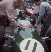 Racing driver Jim Clark in his Lotus talking to mechanics before a race He was world champion in 1963 and 1965 and in all won 25 Grand Prix events