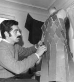 Spanish born dress designer Paco Rabanne at work on one of his metallic dresses