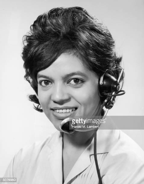 Studio headshot portrait of an AfricanAmerican switchboard operator wearing a headset