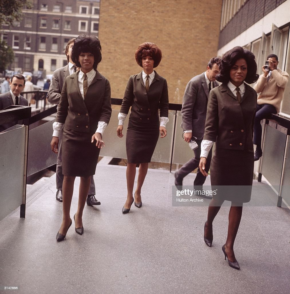 Wearing identical suits even though not performing The Supremes one of the most popular of American female vocal groups