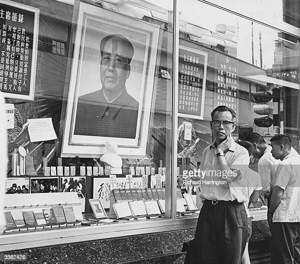 A portrait of Chinese communist leader Mao Zedong on display in a window of the Chinese Merchandise Emporium on Queen's Road Central