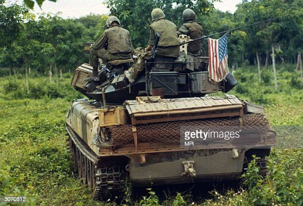 American troops on an assault vehicle awaiting orders