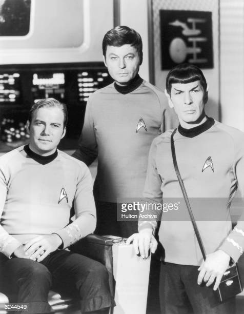 From left to right Canadian actor William Shatner as Captain Kirk American actor DeForest Kelley as Dr 'Bones' McCoy and American actor Leonard Nimoy...