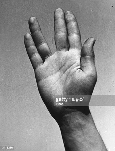 A closeup of a hand signaling a Vulcan salute from the television series 'Star Trek'