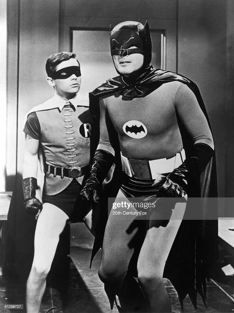 Circa 1967, American actors Burt Ward, left, and Adam West pause in a still from the television series 'Batman'.