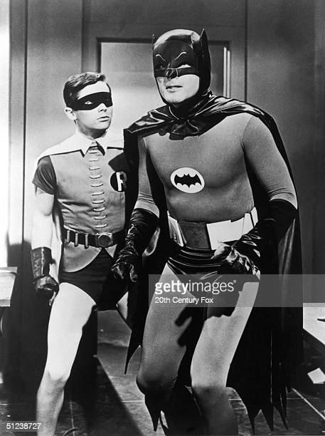Circa 1967 American actors Burt Ward left and Adam West pause in a still from the television series 'Batman'