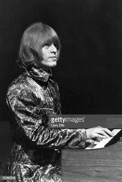 Brian Jones of the Rolling Stones playing keyboards with the group during their television appearance on the Eamonn Andrews Show