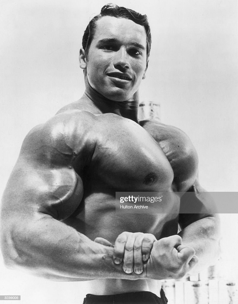 Studio portrait of Austrian-born bodybuilder <a gi-track='captionPersonalityLinkClicked' href=/galleries/search?phrase=Arnold+Schwarzenegger&family=editorial&specificpeople=156406 ng-click='$event.stopPropagation()'>Arnold Schwarzenegger</a> flexing his torso in an advertisement for a German protein product.