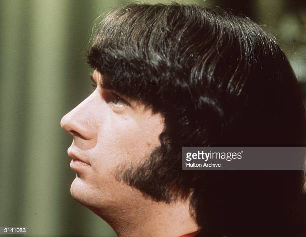Mike Nesmith a guitarist with the manufactured American pop group The Monkees displays his fashionable sideburns
