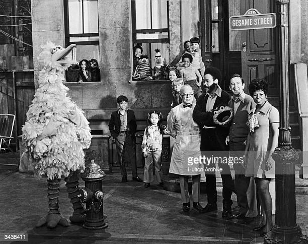 Cast members of the television show 'Sesame Street' posing on the set with some of the puppet characters Left to right Will Lee Matt Robinson Bob...