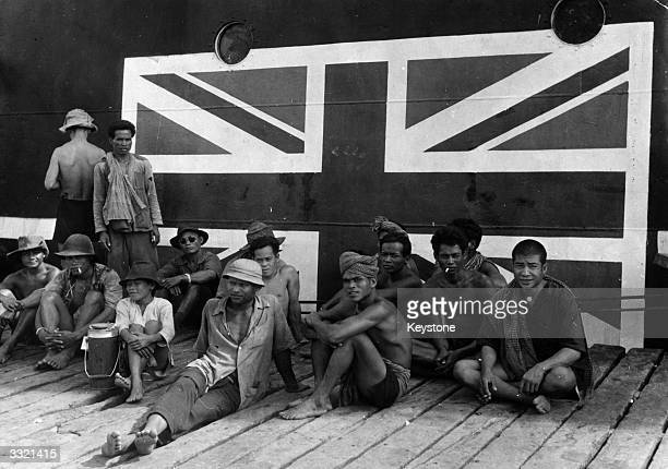 A group of Cambodian dock workers waiting to unload a cargo of sugar from Taiwan from a British cargo ship in Phnom Penh It could be the last...