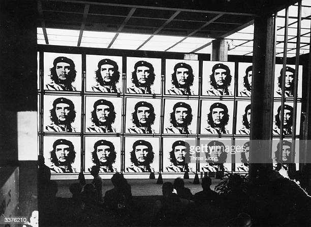 A revolving series of portraits of national hero Che Guevara at The Third World exhibit in Havana Cuba